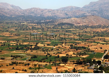 The Lassithi Plateau is a wide expanse of cultivated fields and orchards. Located in eastern Crete, Greece - stock photo