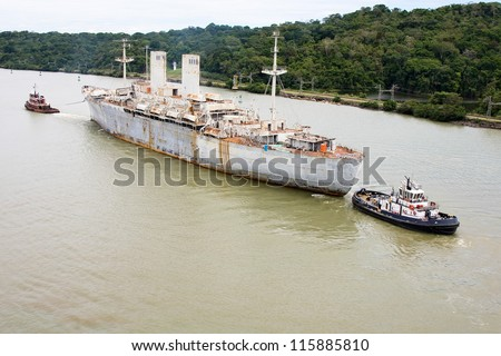 The last voyage of historic war ship USNS General John Pope from West Coast to Brownsville, Texas scrap yard. Picture taken in Panama Canal transit. - stock photo