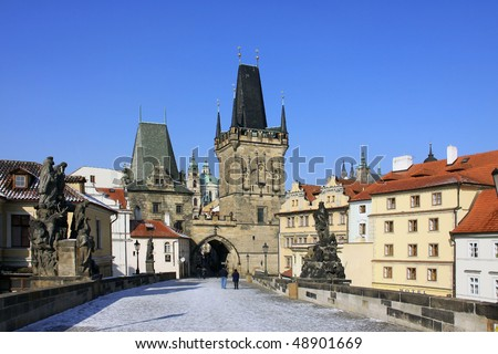 The late Snow in March Prague - view on St. Nicholas' Cathedral with Bridge Tower - stock photo
