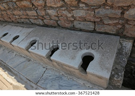 The latrine at the ancient city of Ephesus, located in southwest Turkey.  - stock photo