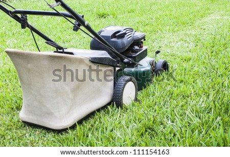 The Lawn mower in the yard