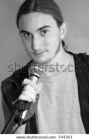 The lead singer of a teen-aged rock band in black and white