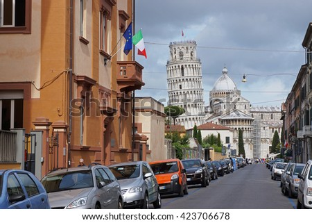 The Leaning Tower of Pisa viewed from a city street, Pisa, Italy  - stock photo