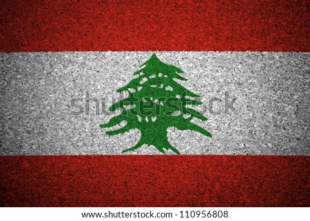 The Lebanese flag painted on a cork board. - stock photo