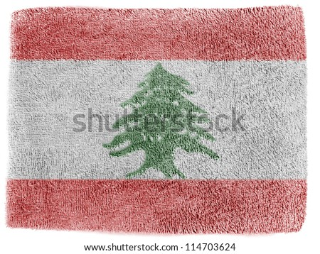 The Lebanese flag painted on grey towel - stock photo