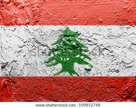 The Lebanese flag painted on grunge wall - stock photo