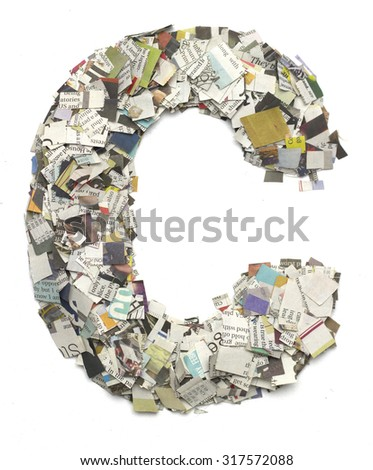 The letter C  made from newspaper confetti - stock photo