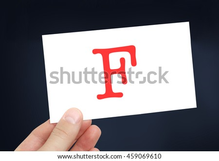 The letter F on a card