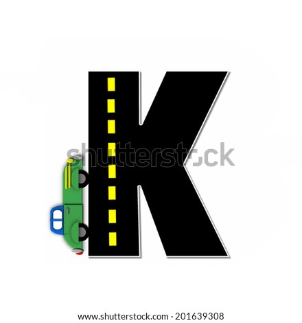 "The letter K, in the alphabet set ""Transportation by Road"", is black with yellow dividing line representing a black top road.  Colorful, motorized vehicle navigates outside of letter. - stock photo"