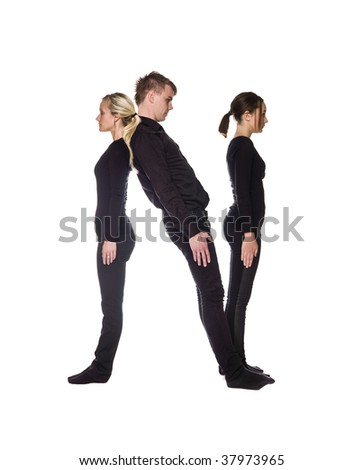 The letter 'N' formed by people dressed in black - stock photo