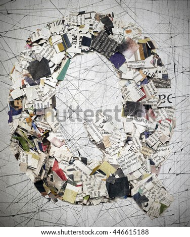 The letter  Q   made from newspaper confetti - stock photo