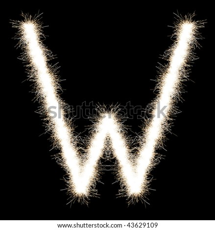 The letter W from a Bengal fire, on a black background, it is isolated.