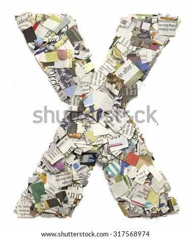The letter  X  made from newspaper confetti - stock photo