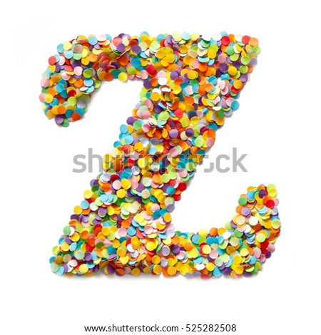 The letter Z is laid out colored confetti. White background.