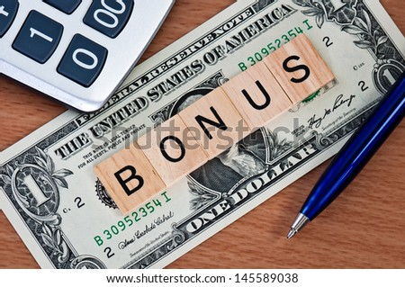 The letters BONUS on  dollar banknote business concept - stock photo