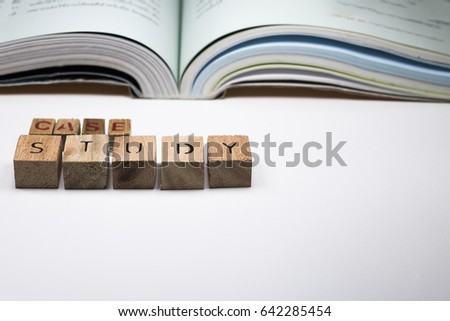 The letters on the tree are arranged in the sentence. A case study with open books. On a white background