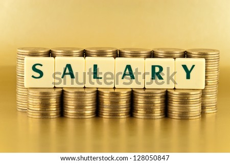 The letters  SALARY with stacks of coins on gold background