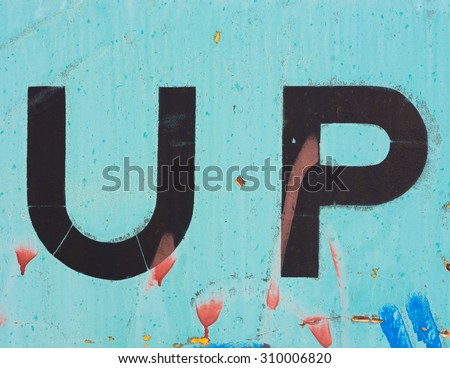 The letters U and P, or the word UP, painted on the side of a train car. - stock photo