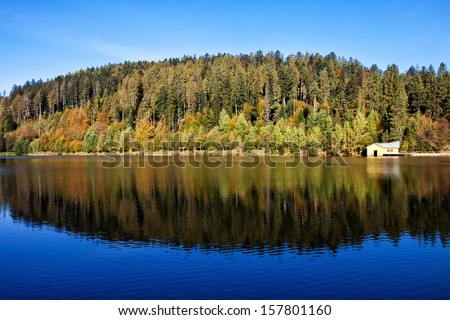 The level of the lake with the reflection of the surrounding landscape autumn