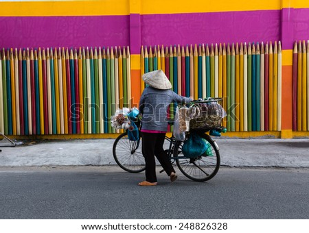 the life of the fruit vendors on the streets of Vietnam with color background. Small business is Mainly in Vietnam. - stock photo