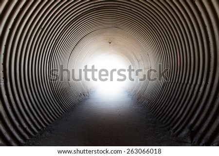 the light at the end in the tunnel. - stock photo