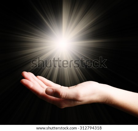 The light in young woman hand - stock photo