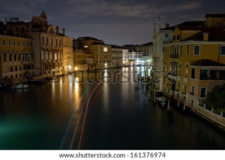 The Light of Venice Long exposure By Night. Blurred motion on curtain due to Grand Canal sea movement.   - stock photo
