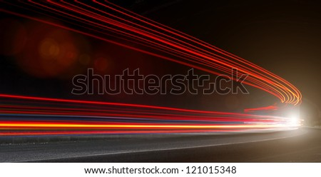 The light trails. Art image . Long exposure photo taken in a tunnel