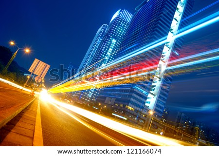 the light trails on the modern building - stock photo