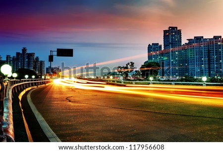 the light trails on the modern building background in china. - stock photo