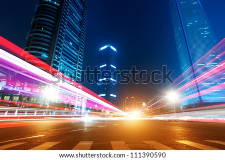 The light trails on the modern building background in shanghai china. - stock photo