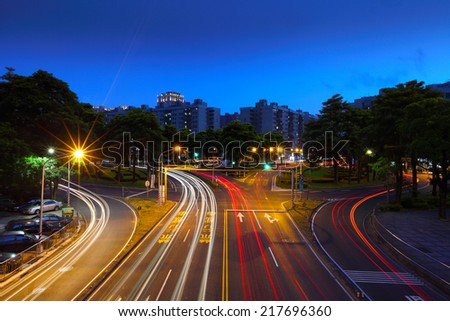 the light trails on the roundabout in Kaohsiung, Taiwan - stock photo