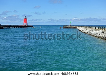 The lighthouse on Lake Michigan at the entrance to the harbor at Charlevoix, Michigan.