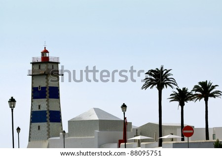 The lighthouse on seaside in Cascais, Portugal. - stock photo