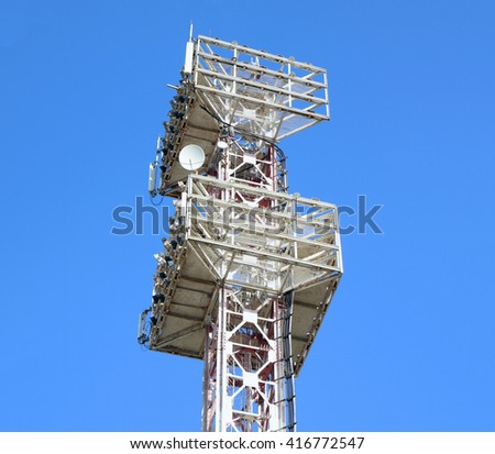 The lighting tower at the football stadium. On the background of blue sky