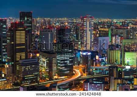 The lights of Osaka turn on as evening settles in over the city. - stock photo