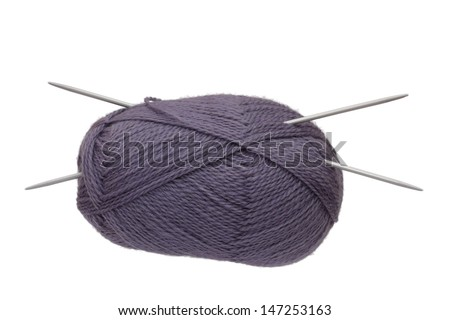 The lilac clue with knitting needles isolated on white background