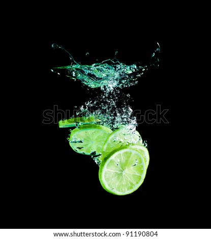 The lime slices falling into water .