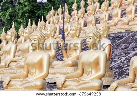 The line of gold Buddha in Laos