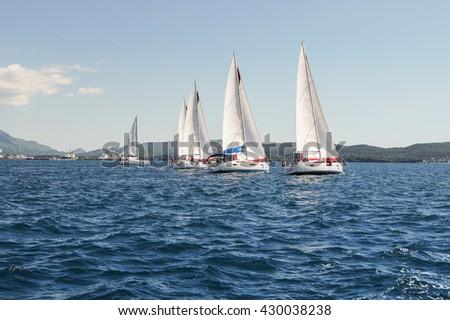 "The line of yachts. Tivat, Montenegro - 26 April, 2016. Regatta ""Russian stream"" in God-Katorskaya bay of the Adriatic Sea off the coast of Montenegro. - stock photo"