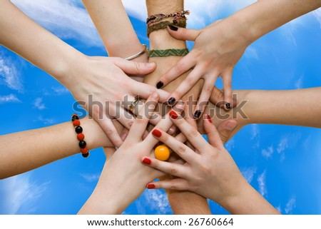 The linked hands symbolizing teamwork and friendship.