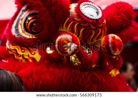 The Lion Dancing at the commemoration of the arrival of the Chinese New Year