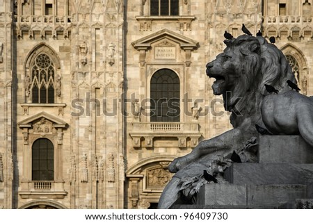 The lion in the piazza A sculpture at the cathedral square in Milan, Italy - stock photo