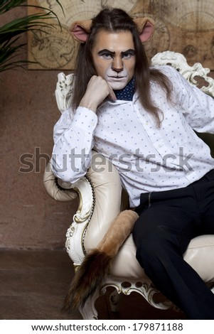 The Lion King is sitting in his office - stock photo