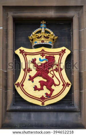 The Lion Rampant crest above the main entrance at Edinburgh Castle in Scotland. - stock photo