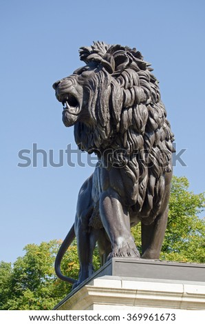 The lion sculpture topping the Maiwand war memorial on public display in Forbury Gardens, Reading, Berkshire.  It commemorates those killed in the Battle of Maiwand  in the late 19th century.
