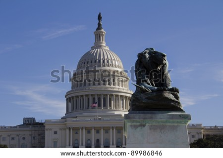 The lion sculpture with US Capitol background  Washington DC