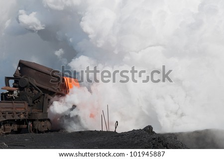 The liquid molten slag and a cloud of hot steam generated during the granulation of the slag.