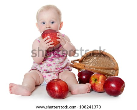 The little baby with red apples isolated - stock photo