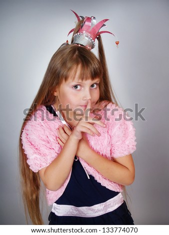 the little beautiful girl the princess asks not to speak - stock photo